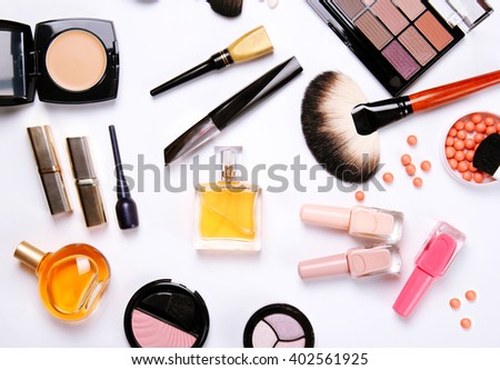 make-up brush, perfume, eye shadow, blush at the white background - stock photo