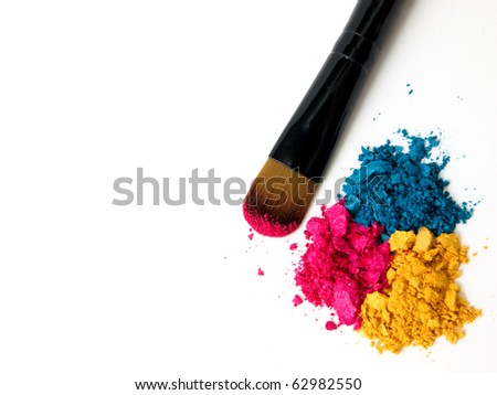 Make-up brush with colorful crushed eyeshadows - stock photo