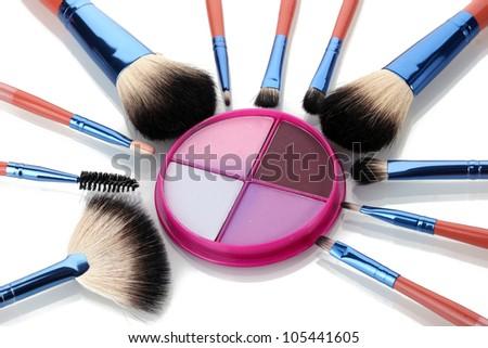 make-up brushes and bright  eyeshadow isolated on white - stock photo