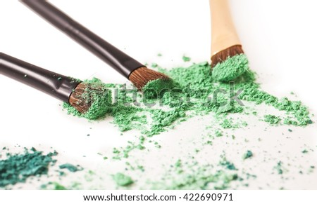 Make-up brushes and cosmetics isolated on a white background - stock photo