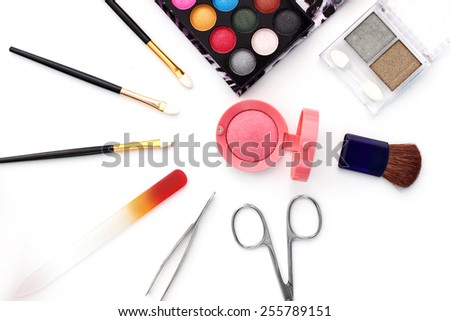 make-up brushes  and cosmetics isolated on white - stock photo
