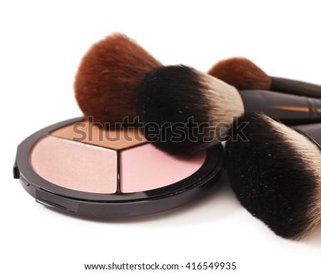 Make-up brushes and cosmetics isolated on white background - stock photo