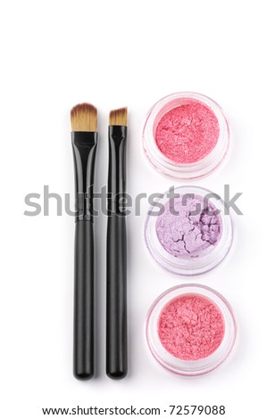 Make-up brushes and powder eye shadows in jars isolated on white background. - stock photo