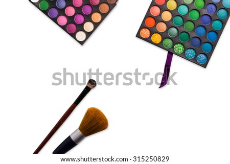 make-up brushes in holder and cosmetics isolated on white - stock photo