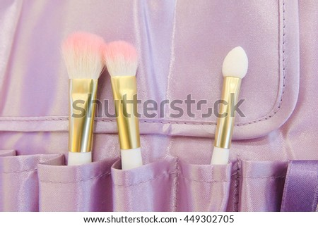 Make Up Brushes or Cosmetic Brushes in a case, with pink shade on top - stock photo