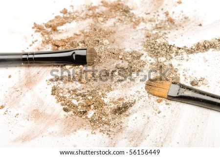Make up brushes with broken eyeshadows.