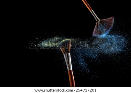 Make up brushes with powder isolated on black background - stock photo