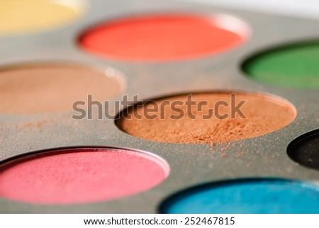 Make up colorful eyeshadow palette - low angle - stock photo