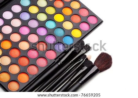 Make-up colorful eyeshadow palette with makeup brushes on it - stock photo