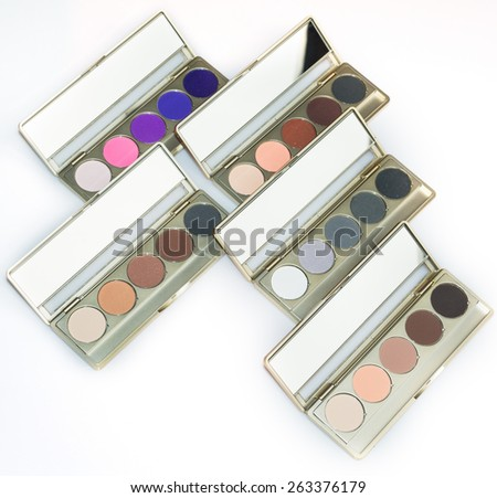 Make-up colorful eyeshadow palettes, as background on white - stock photo