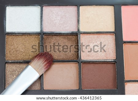 Make-up colorful eyeshadow palettes with makeup brushe. - stock photo