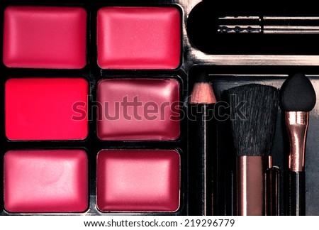 Make-up colorful makeup palette closeup. Lipstick of different colors - stock photo