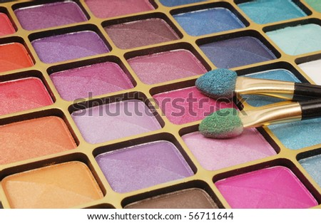 Make up colorful set and two brushes - stock photo