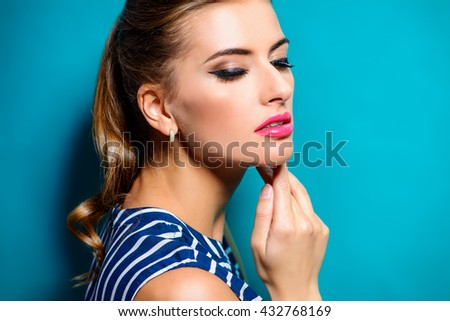 Make-up concept. Close-up portrait of a beautiful young woman with elegant make-up. Beauty, fashion. Cosmetics. - stock photo
