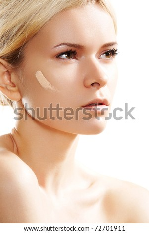 Make-up & cosmetic. Woman applying skin tone foundation on white background - stock photo
