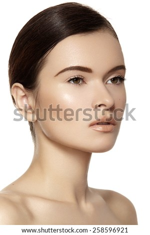 Make-up & cosmetics. Closeup portrait of beautiful woman model face with clean skin on white background. Natural skincare beauty, clean soft skin