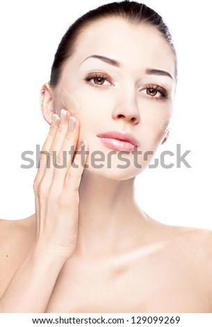 Make-up & cosmetics. Closeup portrait of beautiful woman model face with skin foundation on white background - stock photo