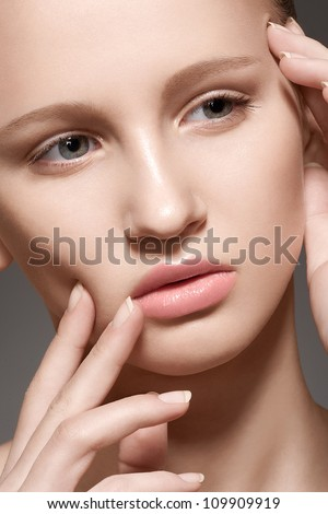 Make-up & cosmetics, manicure. Closeup portrait of beautiful woman model face with clean skin, full glossy lips. Natural skincare beauty, clean soft skin, french manicure