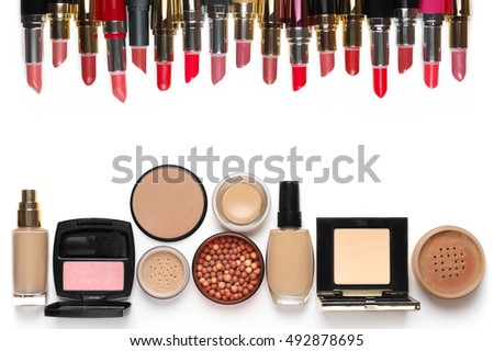 Make-up cosmetics set of liquid and cream foundations, compact and loose powder in various tones, bronzing pearls, blush and multicolored lipsticks isolated on white background. Top view point.
