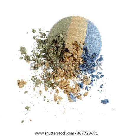 Make up crushed eyeshadow on white background - stock photo