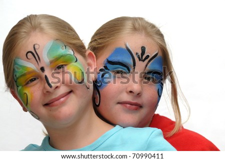 Make up for the carnival drawing of a butterfly on girls face - stock photo