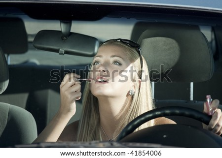Make-up in the car - stock photo