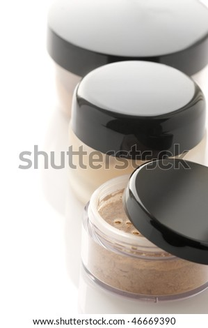 Make-up: jars of loose powder and toner on white background.