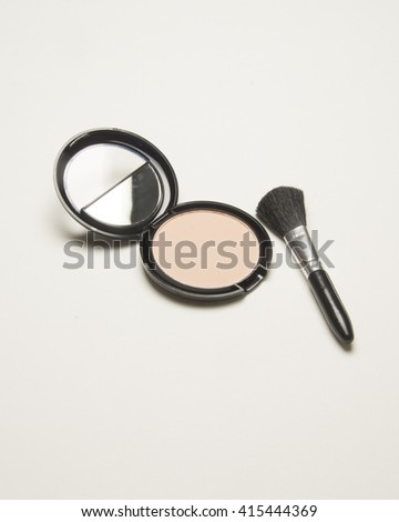 Make up kit/Cosmetic Powder/Make up kit with powder and brush used for application on the skin - stock photo