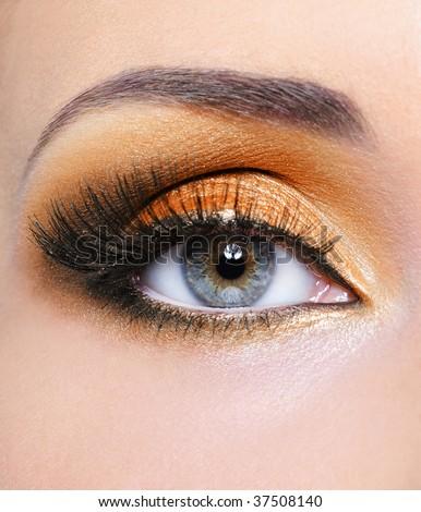 Make-up of woman eye with fashion orange  eyeshadow - stock photo