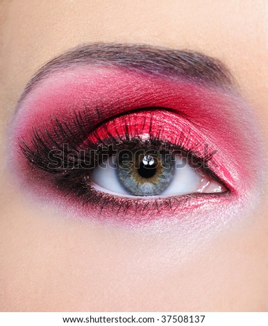 Make-up of woman eye with red bright eyeshadow - macro shot