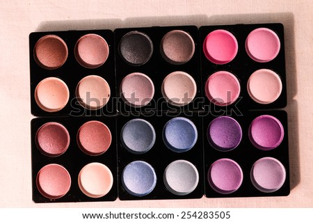 Make-up Palette Of Colorfully Eyeshadows Over White Background - stock photo