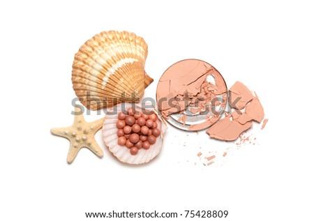 Make up powder and shells - stock photo