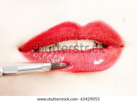 Make-up process, applying lipstick - stock photo