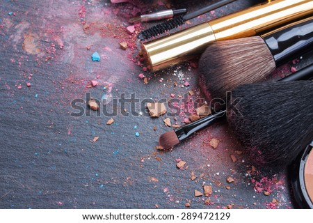 make up set, soft  makeup  brushes and  maskara on black background - stock photo