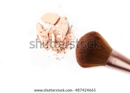 Make-up three brush and crushed powder isolated on white background
