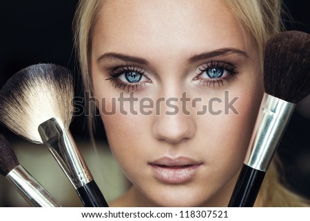 make up woman with makeup brushes - stock photo