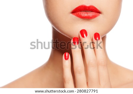 Make your lips match your fingers. Close-up of a beautiful women holding finger on her red lips isolated on the white - stock photo