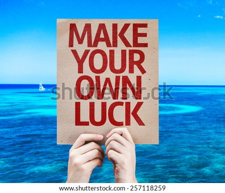 Make Your Own Luck card with beach background - stock photo