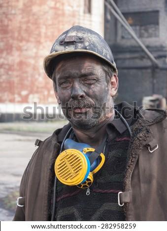 Makeevka, Ukraine - October 30, 2012: Miner mine Yasinovskaya-Glubokaya after work shift  - stock photo