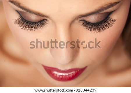 Makeup and artificial eyelashes - stock photo