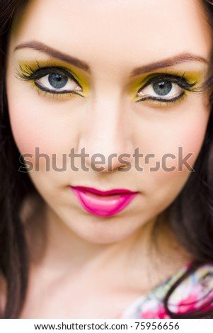 Makeup And Beauty Concept With The Face Of An Attractive Stunning And Beautiful Woman Model With Flawless Skin Wearing Colorful And Vibrant Cosmetics