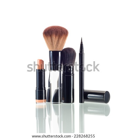 makeup and cosmetics with drop shadow isolated on white - stock photo