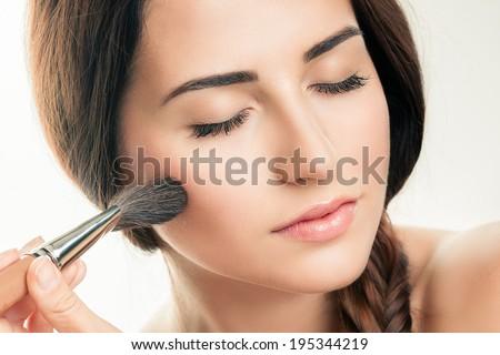 Makeup Applying  closeup. Cosmetic Powder Brush. Perfect Skin - stock photo