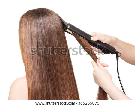 Makeup artist aligns long hair Curling on a white background