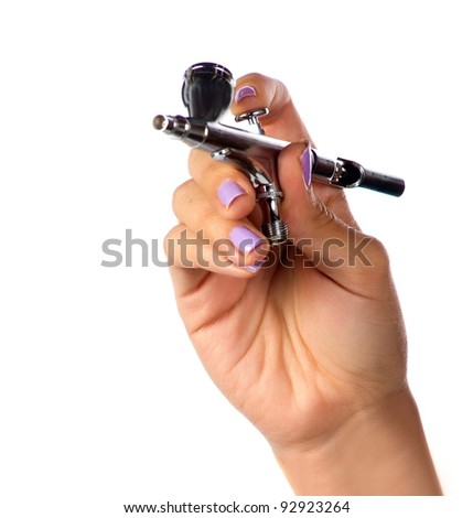 Makeup artist holding the tools of her trade - stock photo