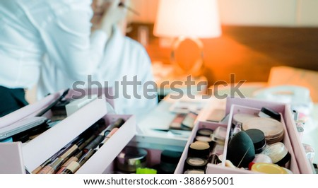makeup artist makes young beautiful bride bridal makeup - stock photo