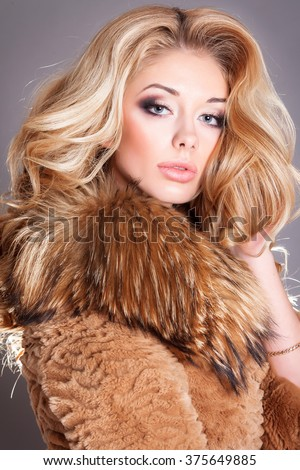 Something Beautiful blonde in fur coat all