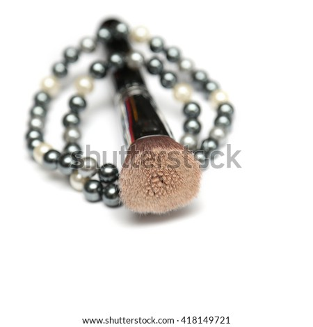 Makeup black brush with beading isolated on white background. Silver, white and black beads.