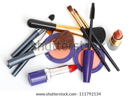 makeup brush and cosmetics isolated on white
