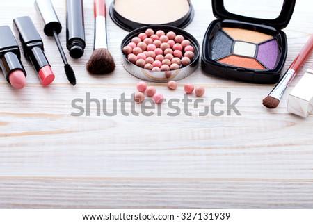 makeup brush and cosmetics make up artist objects: lipstick, eye shadows, eyeliner, concealer, nail polish, powder, tools for make-up - stock photo